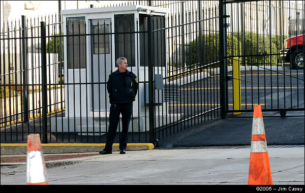 An officer stands in front of the newly installed guard shack and fence at the Federal Courthouse. These security measures were apparently inspired in part by Rudolph's first Huntsville visit last summer.