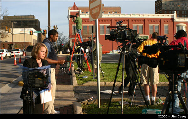 """Television crews from Huntsville and Birmingham line up as they prepare to broadcast """"live at 5"""" while others remain vigilant watching the door for a sign of Rudolph's emergence."""