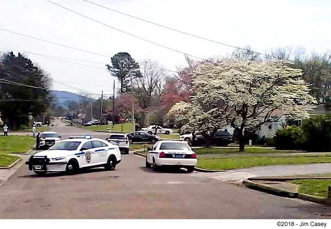 Police surround a suspect in West Huntsville